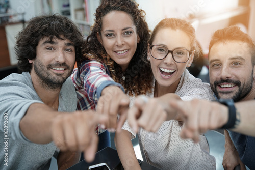 Group of start-up people in office pointing at camera Plakat