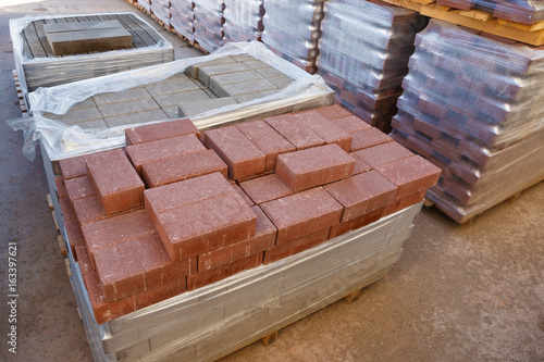 Pavers on pallets wrapped in plastic | Buy Photos | AP Images