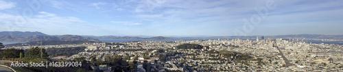 San Francisco panorama under blue sky.