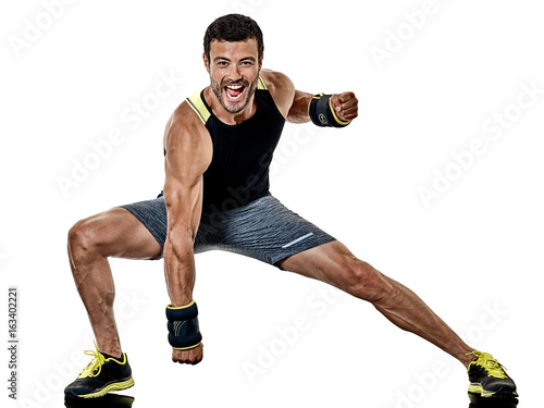 Fototapeta one caucasian fitness man exercising cardio boxing exercises in studio  isolated on white background