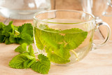 Melissa tea - hot water poured over fresh melissa leaves - 163410097