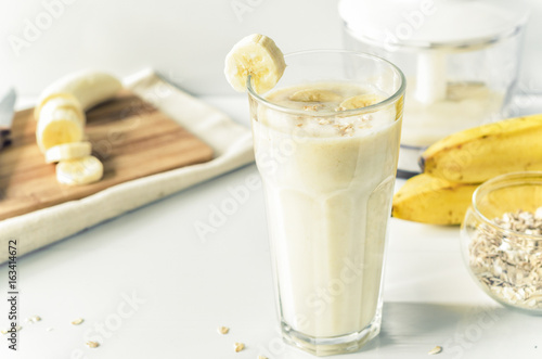 Canvas Milkshake Milkshake with banana and oatmeal , healthy breakfast