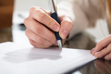 Business Person Signing Document With Pen