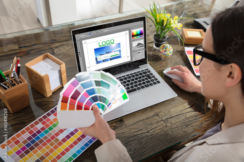 Business Woman Making Color Selection For Logo Design Poster