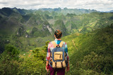 Hipster woman traveler with backpack enjoying a beautiful view of the unusual forms of mountains - 163427644