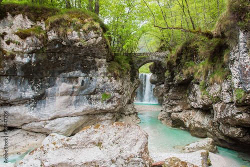 Fotobehang Bos rivier Waterfalls. Crystalline water. Mountain creek. Chiusaforte, Friuli