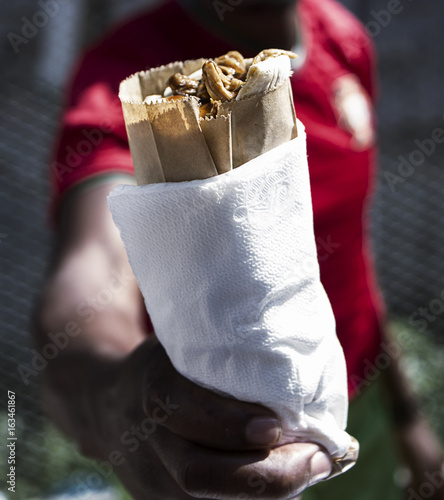 Man Holding Wrapped Food