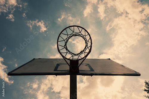 basketball backboard on blue cloudy sky background