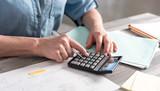 Female accountant using calculator
