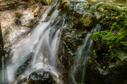 Gentle spring fed waterfall - 163470016