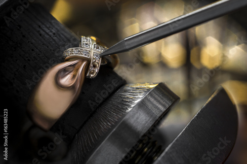 The jeweler fixes the diamonds. © FotoBrest