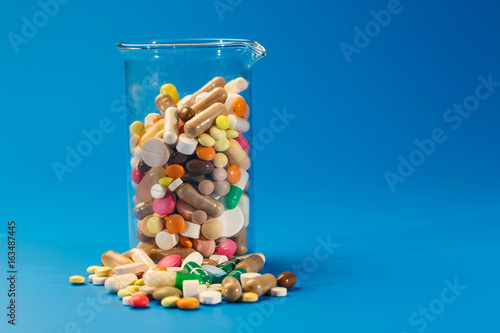 Tablets and capsules in a glass