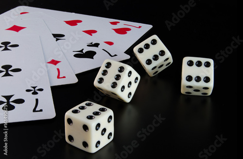 Dice, playing cards on a black background Poster
