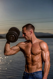 fitness muscular male model with weights - 163496224