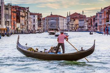 Men In Gondola On Canal In City, Venice, Italy