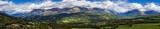 Panoramic summer afternoon view on the Champsaur and the Drac Valley. From left to right the villages of Saint-Bonnet-en-Champsaur abd Saint-Julien-en-Champsaur. Hautes-Alpes, PACA, France - 163540859