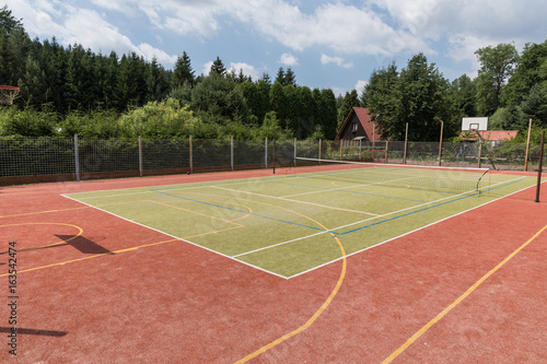 Outdoor playground for tennis, volleyball and football.