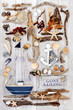 Abstract seaside collage with decorative sailing and nautical items with driftwood, seashells, rocks and seaweed on white distressed wood background.