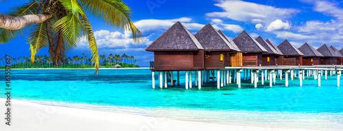 Fotobehang Freesurf luxury Maldives vacation - panorama with water bungalows