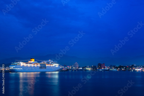 South Korea. A night view of Sokcho Port where A luxury cruise ship is anchored.