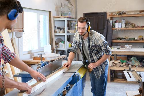 Deurstickers Fietsen Handsome young carpenters in workshop