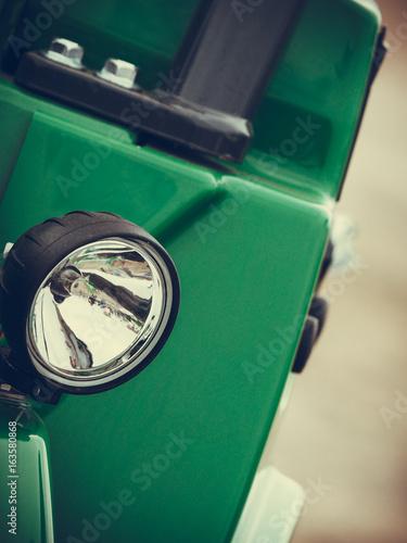 Reflector on big heavy green vehicle