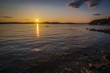 Sunset with a Ice Berg in view along a coastal area of Green Bay near Langdon's Cove, Newfoundland & Labrador