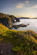 Sunset with a natural bridge in view along a coastal area of Green Bay near Langdon's Cove, Newfoundland & Labrador