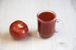Cup of tomato juice and whole tomato