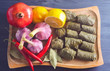 Stuffed delicious dolma with ingredients and lemon on wooden Board