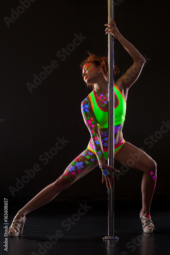 Sexy pole dancer with glowing patterns on her body - 163608657