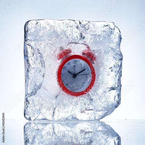 Frozen red alarm clock