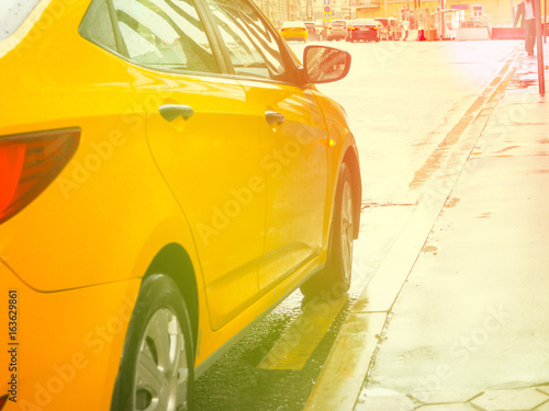 Yellow taxis in the city, sunset and flare, selective focus