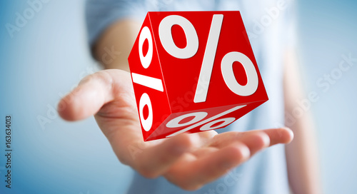 Businessman using white and red sales flying icons 3D rendering - 163634013