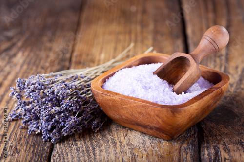 Lavender bath salt and dried flowers of lavender
