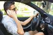 young driving talking on mobile phone man