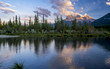 Three Sisters at sunset along the Bow River in Alberta Canada