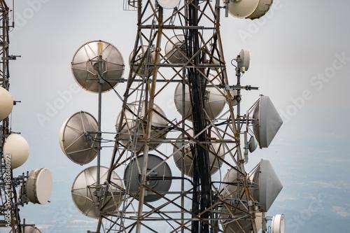 telecom cellular Communication Antenna tower on blue background