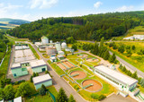 Aerial view of public sewage treatment plant for 22, 000 inhabitants of Klatovy city in Czech Republic, Europe. Environment and industry from above.  - 163701280