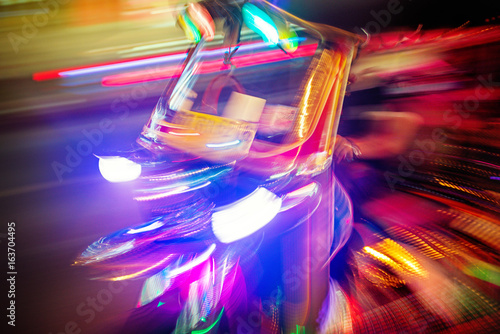Tuk tuk taxi at night. Motion blurred art type photo