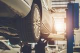 Mechanic repairing a car - 163714290