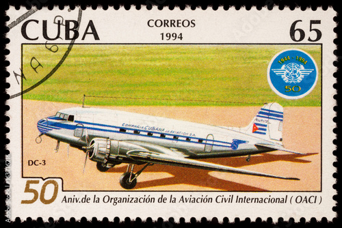 Poster Old passenger aircraft DC-3 on postage stamp