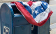 Flag draped over mailboxes