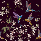 Humming bird and blossoming cherry embroidery seamless pattern. Beautiful hummingbirds and white blossoming cherry sakura flowers on black background. Template for clothes, textiles, t-shirt design - 163718877