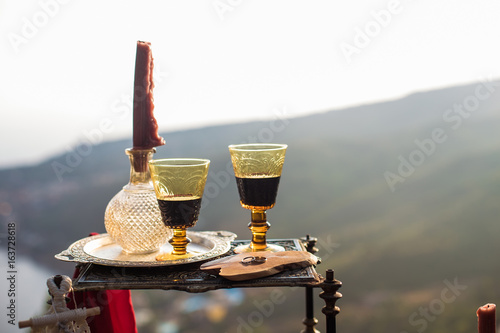 Two glasses of wine on a background of mountains Poster