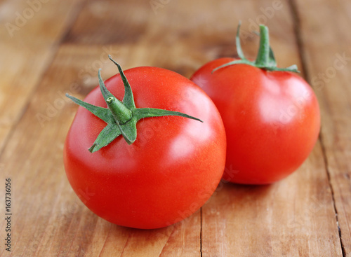 Two ripe tomatoes on the table. - 163736056