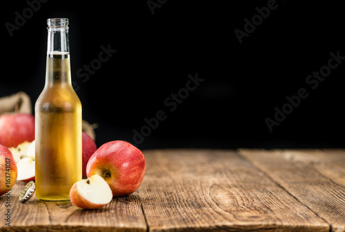 Apple Cider (selective focus) on vintage wooden background - 163741017