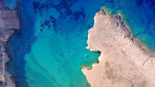 Aerial drone photo of famous caves of Ksylobatis near Pori beach, Koufonissi island. Cyclades, Greece