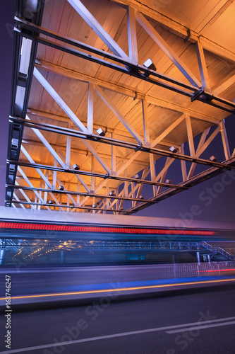 Pedestrian bridge with traffic in motion blur at night, Beijing center, China