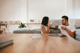 Young couple having coffee at home - 163751825